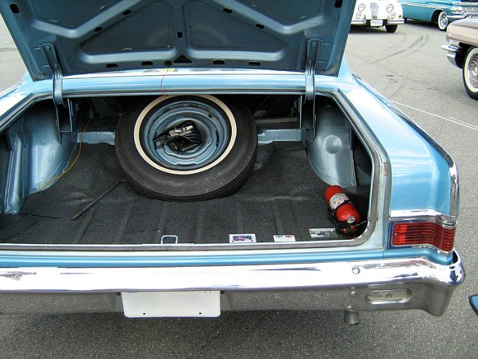 An open trunk of a vintage car