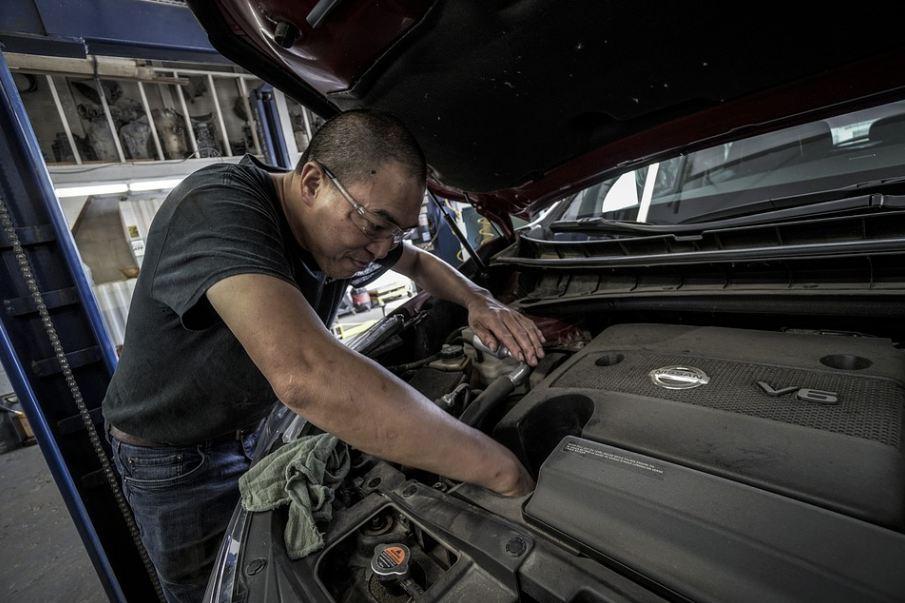 a man checking a NISSAN car engine