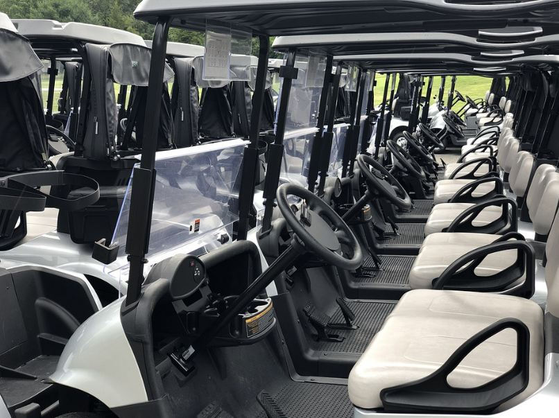 electric golf carts lined up
