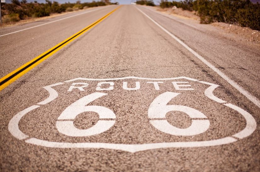 long road, route 66 sign, white and yellow road lines