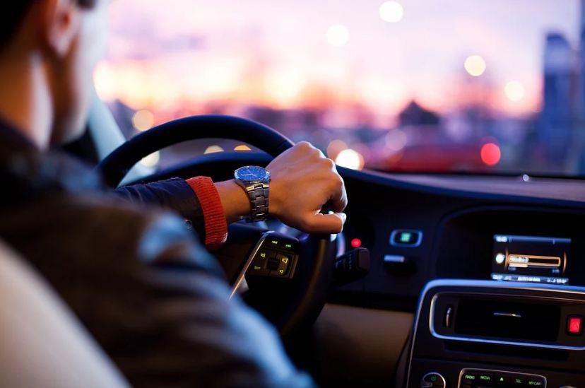 man wearing a long sleeves polo, man driving the car, elegant car interior